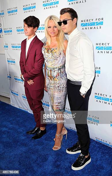 Actress Pamela Anderson poses with sons Dylan Jagger Lee and Brandon Thomas Lee at the Hidden Heroes Gala presented by Mercy for Animals at Unici...