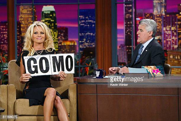 Actress Pamela Anderson shows her support for 2004 USA Olympic female gymnast Mohini Bhardwaj on 'The Tonight Show with Jay Leno' at the NBC Studios...