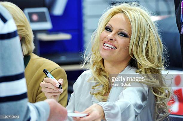 US actress Pamela Anderson signs autographs at Lugner City on March 05 2012 in Vienna Austria