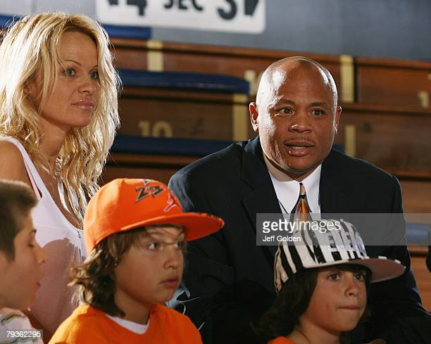 Actress Pamela Anderson sits with her sons Brandon Thomas Lee and Dylan Jagger Lee and Maurice Hilliard Academic Support Coordinator for Pepperdine...