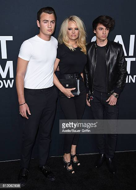 Actress Pamela Anderson sons Brandon Thomas Lee and Dylan Jagger Lee arrive at SAINT LAURENT At The Palladium at Hollywood Palladium on February 10...