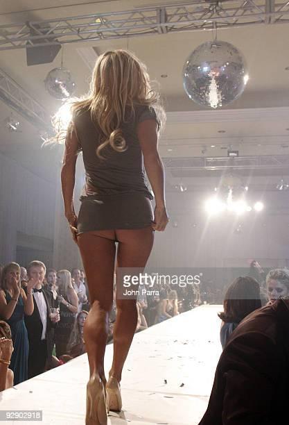 Actress Pamela Anderson walks the runway during the Richie Rich A Muse show at the 15th Annual InterContinental Miami MakeAWish Ball at...