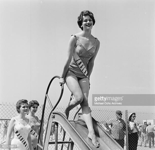 Actress Pamela Searle as Miss England poses at the swimming pool in Los AngelesCA