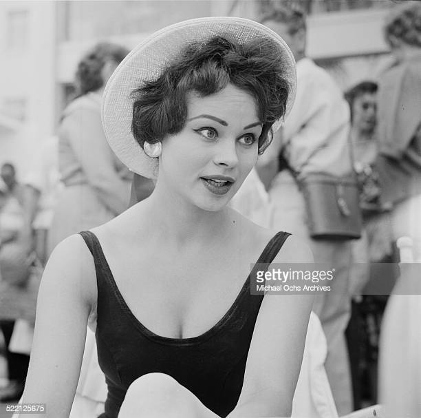 Actress Pamela Searle poses at the swimming pool in Los AngelesCA