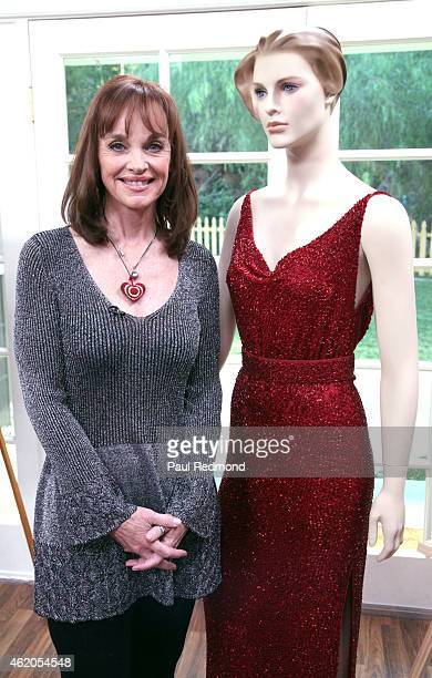 Actress Pamela Sue Martin and a dress she wore on the series photographed on the set of 'Dynasty' Reunion on 'Home Family' at Universal Studios...