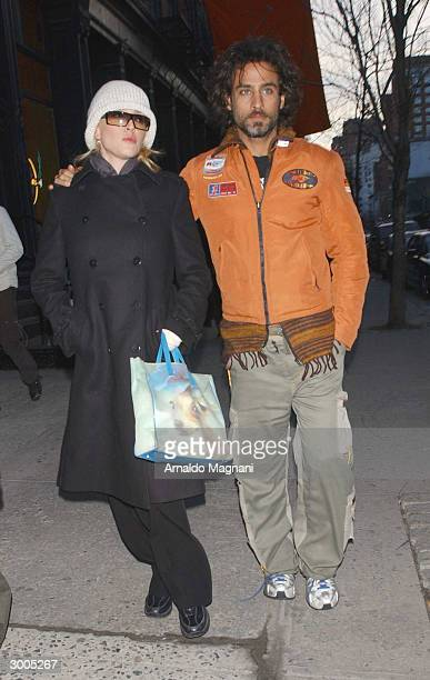 Actress Paola Barale and her fiancee actor Raz Degan walk together along West Broadway February 22 2004 in the SoHo district of New York City