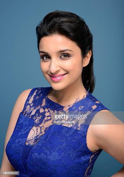 Actress Parineeti Chopra of 'Random Desi Romance' poses at the Guess Portrait Studio during 2013 Toronto International Film Festival on September 11...