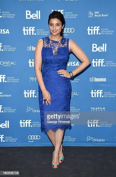 Actress Parineeti Chopra poses at the 'A Random Desi Romance' Press Conference during the 2013 Toronto International Film Festival at TIFF Bell...