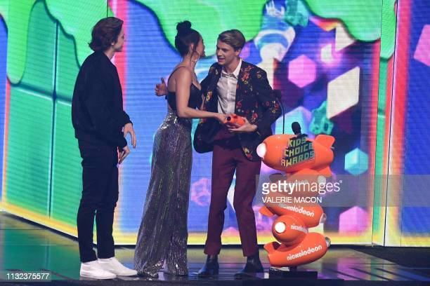 Actress Paris Berelc presents Favorite Male TV Star winner for Henry Danger Jace Norman with his award on stage during the 32nd Annual Nickelodeon...