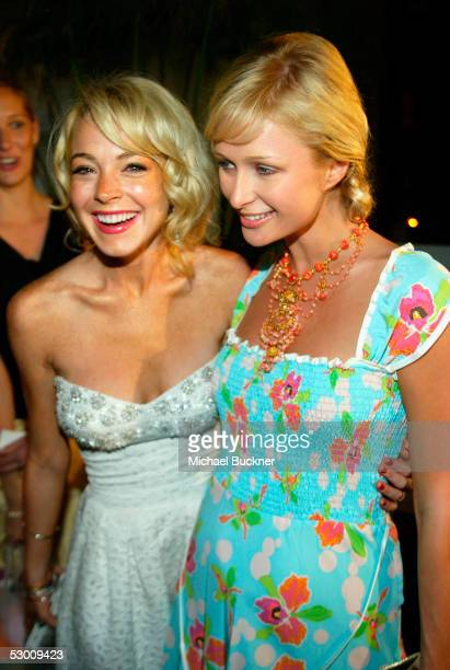 Actress Paris Hilton and actress Lindsay Lohan pose for pictures at the Evening with an Icon Happy Birthday Marilyn Monroe auction at Meson G on June...