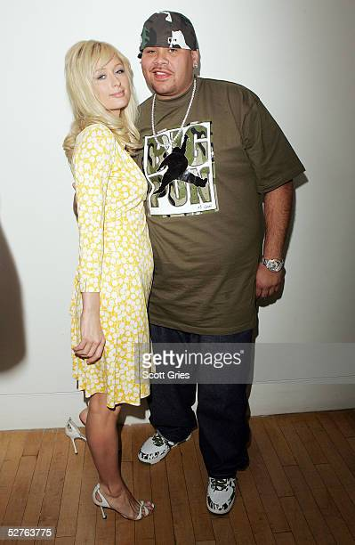 Actress Paris Hilton and rapper Fat Joe pose for a photo backstage during MTV's Total Request Live at the MTV Times Square Studios on May 5 2005 in...