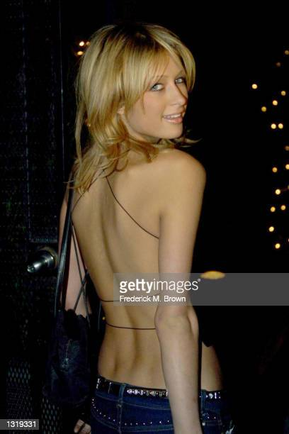 Actress Paris Hilton arrives for the 'Geneva Vs The Grinch' launch party of Gota Gota Entertainment December 18 2000 in Beverly Hills CA