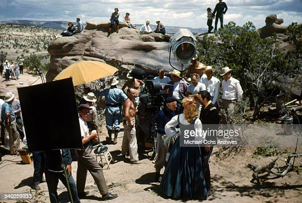 Actress Patrice Wymore gets ready on set as she listens to director William Keighley as a film crew films the movie Rocky Mountain on location in...