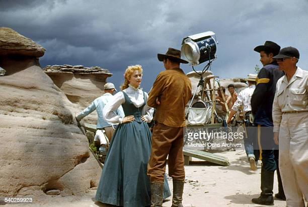 Actress Patrice Wymore talks with actor Errol Flynn on set as a film crew films the movie 'Rocky Mountain' on location in Gallop New MexicoStarring...