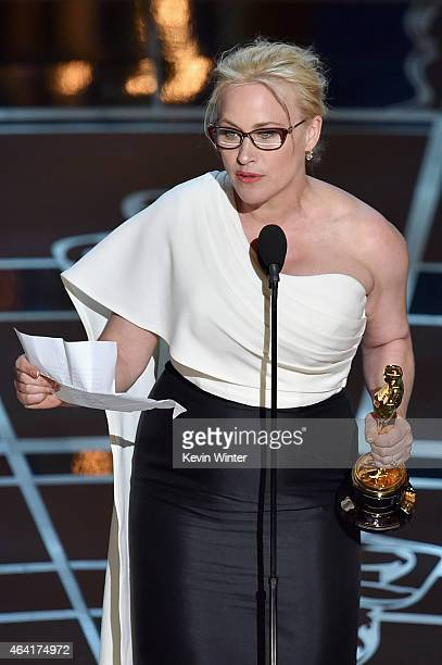 """Actress Patricia Arquette accepts the award for Best Actress in a Supporting Role for """"Boyhood"""" during the 87th Annual Academy Awards at Dolby..."""