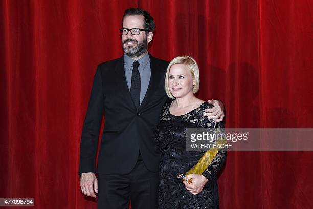 US actress Patricia Arquette and companion Eric White pose during the opening ceremony of the 55th MonteCarlo Television Festival on June 13 in...
