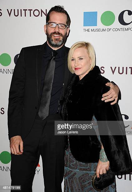 Actress Patricia Arquette and guest attends the MOCA 35th anniversary gala celebration at The Geffen Contemporary at MOCA on March 29 2014 in Los...