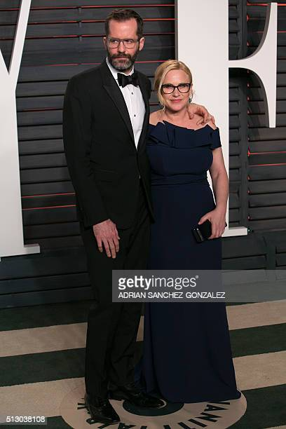 US actress Patricia Arquette and her partner Eric White pose as they arrive to the 2016 Vanity Fair Oscar Party in Beverly Hills California on...