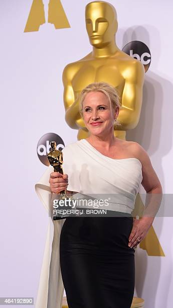 Actress Patricia Arquette poses with her Best Suppporting Actress Oscar for Boyhood in the press room during the 87th Oscars on February 22 2015 in...
