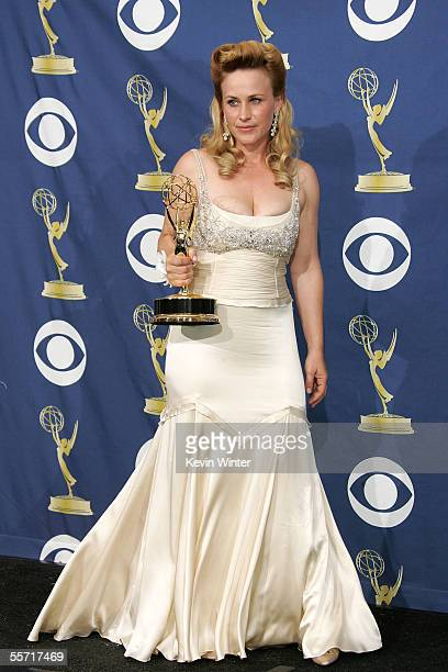 Actress Patricia Arquette poses with her Emmy for Outstanding Lead Actress Drama in the press room at the 57th Annual Emmy Awards held at the Shrine...