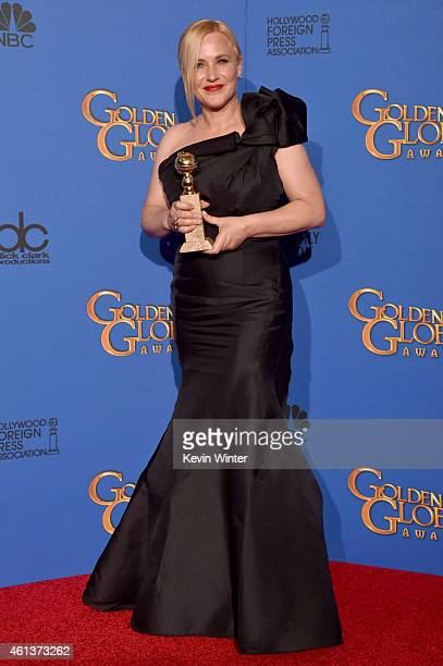 Actress Patricia Arquette winner of Best Supporting Actress in a Motion Picture Drama Musical or Comedy for 'Boyhood' poses in the press room during...
