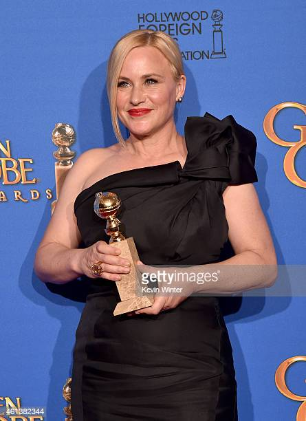 Actress Patricia Arquette, winner of Best Supporting Actress in a Motion Picture - Drama, Musical or Comedy for 'Boyhood,' poses in the press room...