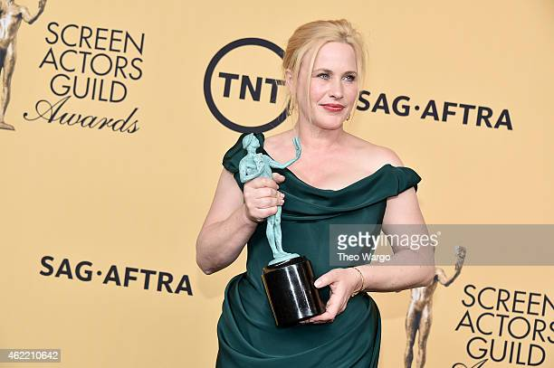 Actress Patricia Arquette, winner of Outstanding Performance by a Female Actor in a Supporting Role for 'Boyhood,' poses in the press room at TNT's...