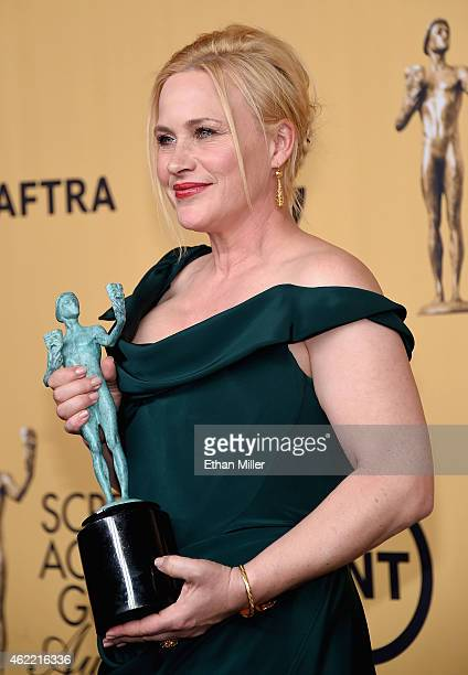 Actress Patricia Arquette winner of Outstanding Performance by a Female Actor in a Supporting Role for 'Boyhood' poses in the press room at the 21st...