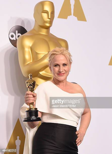 Actress Patricia Arquette winner of the award for Best Actress in a Supporting Role for 'Boyhood' poses in the press room during the 87th Annual...