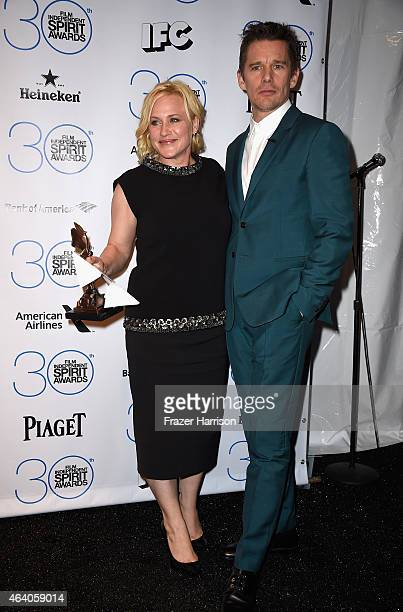 Actress Patricia Arquette winner of the Best Supporting Female Award for Boyhood poses with presenter Ethan Hawke in the press room during the 2015...