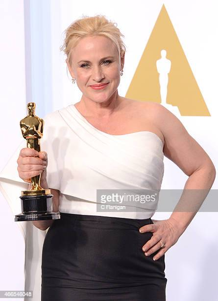 Actress Patricia Arquette, with the award for best actress in a supporting role for 'Boyhood' poses in the press room during the 87th Annual Academy...