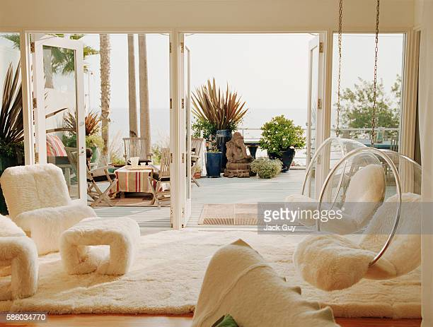 Actress Patricia Arquette's home is photographed in 2005 in Malibu California The living room with a sheepskinned alcove which includes lucite bubble...