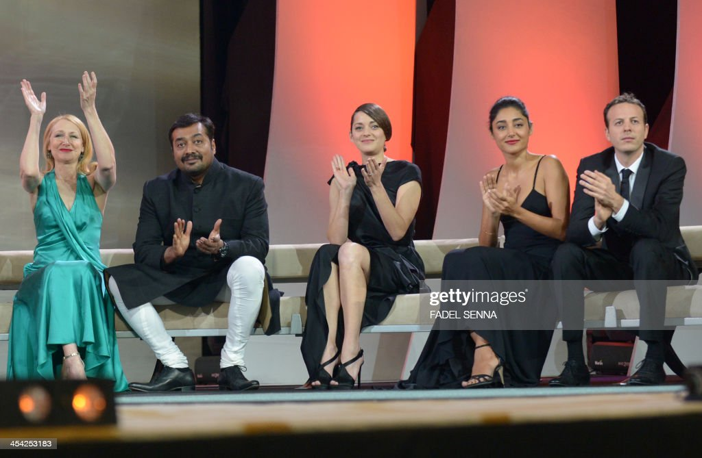 U.S. actress Patricia Clarkson, film director Anurag Kashyap from India, French actress Marion Cotillard, Iranian actress Golshifteh Farahani and Mexican director Amat Escalante sit together during the closing ceremony of the 13th Marrakech International Film Festival on December 7, 2013, in Marrakech.