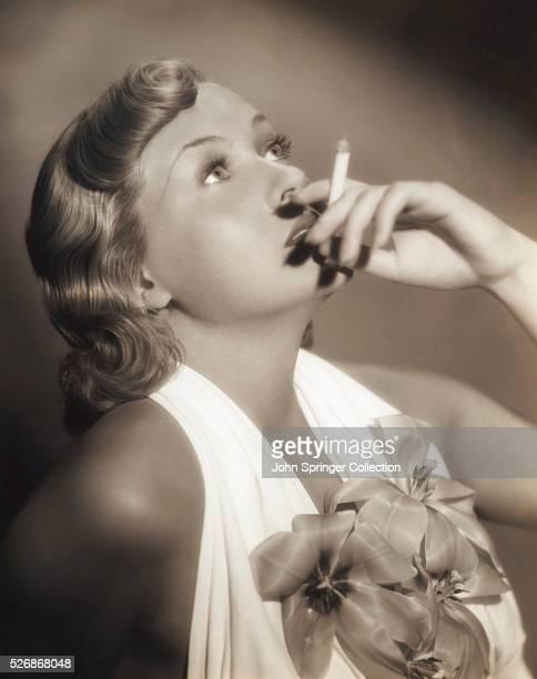 Actress Patricia Ellis Smoking Cigarette