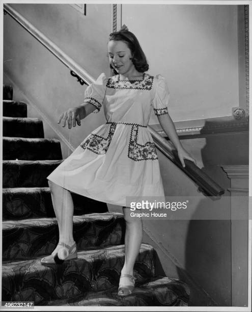 Actress Patricia Hitchcock daughter of director Alfred Hitchcock playing with a yoyo on a staircase circa 19451950