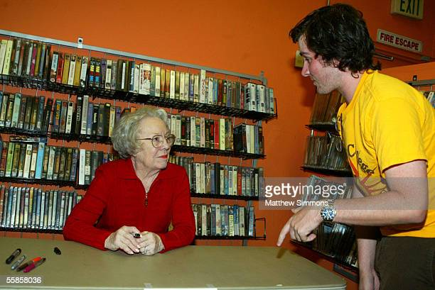 Actress Patricia Hitchcock O'Connell speaks to Hitchcock fan Ben Falk during a signing at Rocket Video on October 5 2005 in Hollywood California