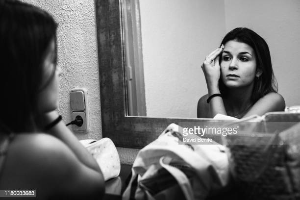 Actress Patricia Martinez puts on makeup in the dressing room of Teatro Cofidis Alcazar on September 15, 2019 in Madrid, Spain.