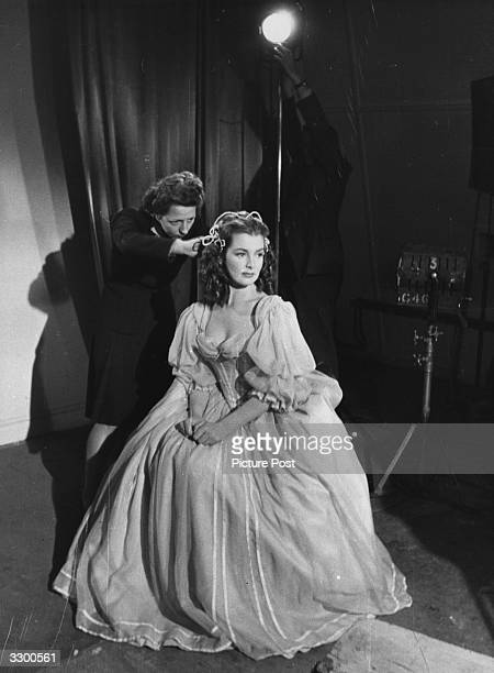 Actress Patricia Roc having adjustments made to her hair during the filming of 'The Wicked Lady' the story of a 17th century highwaywoman directed by...