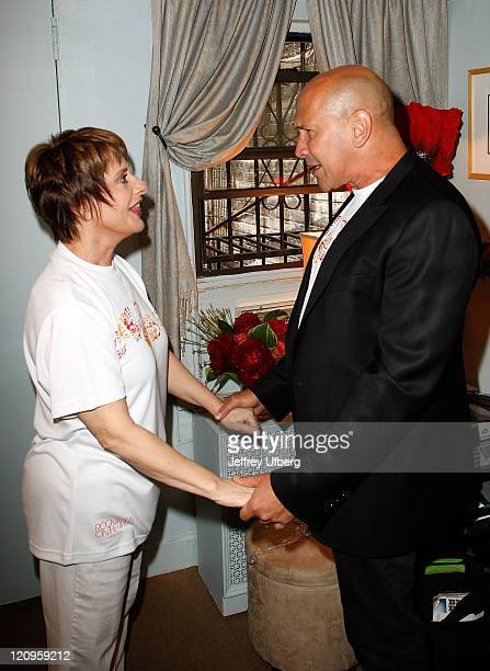 Actress Patti Lupone and fashion designer Carmen Marc Valvo attend a photo call prior to the 2nd Annual Memorial SloanKettering Rock and Run on the...