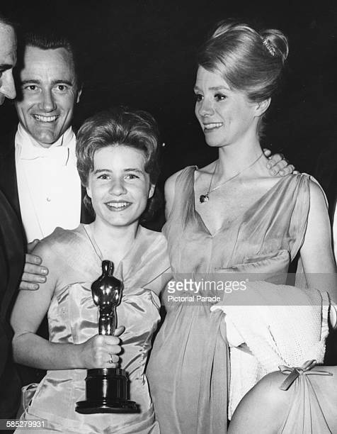 Actress Patty Duke holding her Best Supporting Actress Oscar for the film 'The Miracle Worker' with Robert Vaughn and Inger Stevens at the 35th...