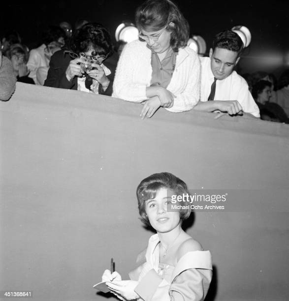 Actress Patty Duke signs autographs as she attends a party in Los Angeles California