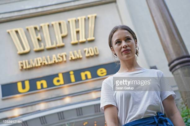 """Actress Paula Beer attends the film """"Undine"""" at the Delphi movie theatre on the first day cinemas have been allowed to reopen in Berlin during the..."""
