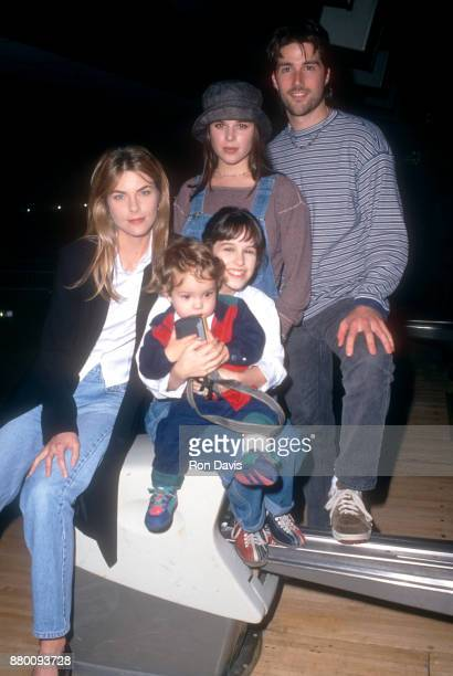 Actress Paula Devicq actress Neve Campbell actor Matthew Fox and actress Lacey Chabert the cast of 'Party Of Five' pose in a bowling alley circa 1996...