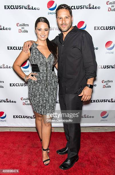Actress Paula Garces and husband Antonio Hernandez attend the New York Launch party for Exclusivleecom at Stray Kat Gallery on September 18 2014 in...
