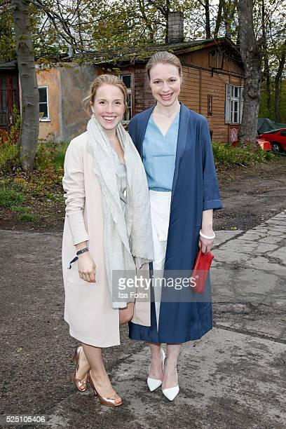 Actress Paula Kalenberg, wearing a dress of COS and actress Anna Brueggemann, wearing a dress of COS, attend the presentation of a joint project by...