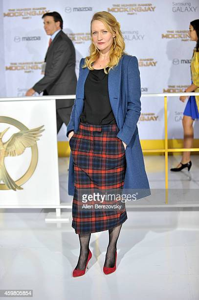"""Actress Paula Malcomson arrives at the Los Angeles premiere of """"The Hunger Games: Mockingjay - Part 1"""" at Nokia Theatre L.A. Live on November 17,..."""