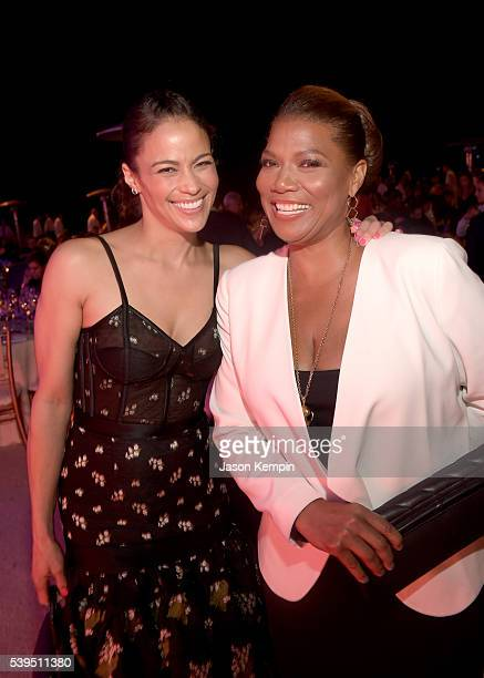 Actress Paula Patton and honoree Queen Latifah attend the 15th Annual Chrysalis Butterfly Ball at a Private Residence on June 11 2016 in Brentwood...