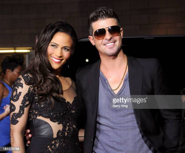 Actress Paula Patton and husband singer Robin Thicke arrive at the Los Angeles premiere of 'Baggage Claim' on September 25 2013 at Regal Cinemas LA...