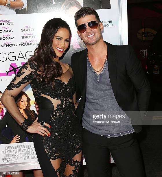 Actress Paula Patton and recording artist Robin Thicke attend the premiere of Fox Searchlight Pictures' Baggage Claim at the Regal Cinemas LA Live on...