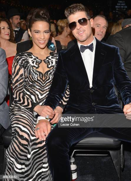 Actress Paula Patton and recording artist Robin Thicke attend the 56th GRAMMY Awards at Staples Center on January 26 2014 in Los Angeles California